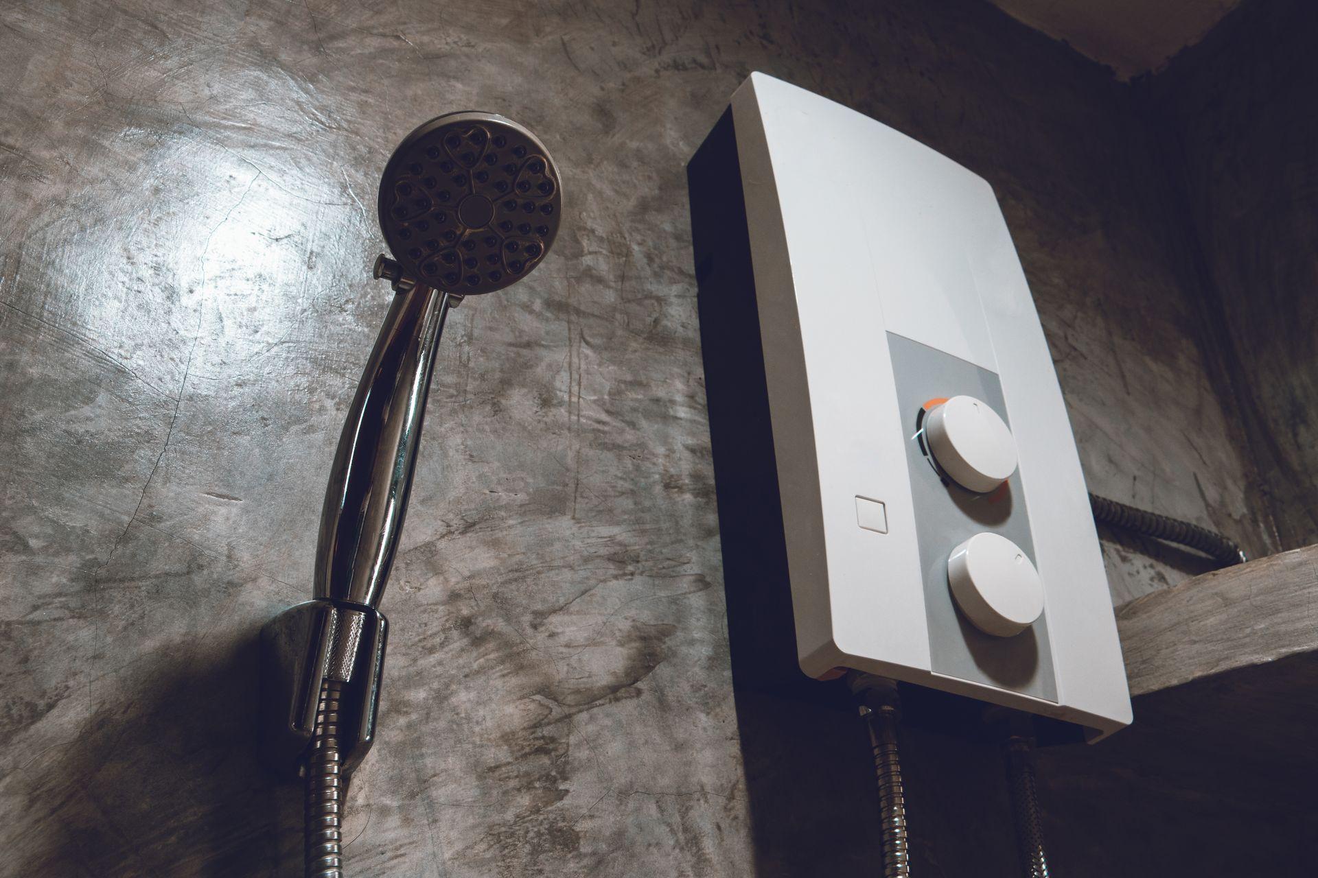 Showerhead and hot water tank on Hamilton bathroom wall